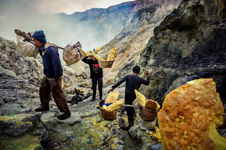 Ijen Sulfur Miner taking sulfur from crater